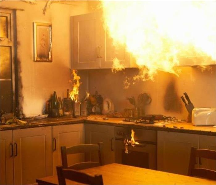 Kitchen on fire after a grease explosion